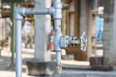 Old gate valve close industrial plant Stock Image