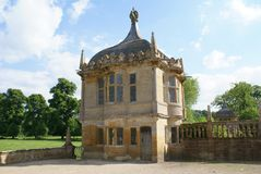 Old Gatehouse. Decorative old gatehouse with a dome, bay windows, and battlements Stock Image