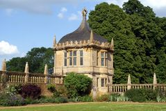 Old gatehouse. Ornate old gatehouse with a dome, bay windows, and battlements Royalty Free Stock Images