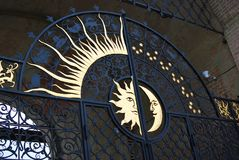 Old gates with sun and half-moon. Royalty Free Stock Image