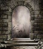 Old gateway with skulls Royalty Free Stock Image
