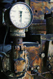 Old gauge on a rusty machine Stock Photos