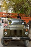 Old Gaz crane with operator out of focus, in Baku, capital of Azerbaijan Royalty Free Stock Images