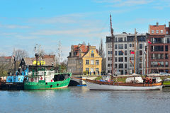 Old Gdansk Harbor With Ships Mooring. Old ships near old hotel and new apartment houses near old harbor canal in Gdansk, Poland Royalty Free Stock Photo