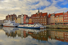 Old Gdansk panorama with harbor canal. Panorama of the waterfront of Old City in Gdansk, Northern Poland, with gothic and renaissance buildings, and two smaller Stock Photos