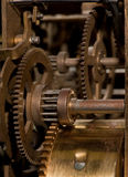 Old gear. Fragment of the mechanism of ancient clocks Stock Image
