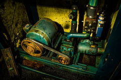 Old Gear Box. Taken in the basement of an abandoned building Royalty Free Stock Photo