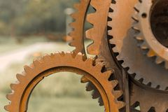 Old gears and cogs. Against blurred background Stock Photography