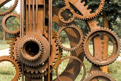 Old gears and cogs. Against blurred background Stock Photo