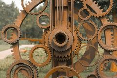 Old gears and cogs. Against blurred background Stock Photos