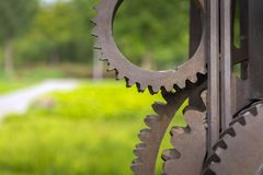 Old gears and cogs. Against blurred background Royalty Free Stock Photography