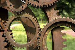 Old gears and cogs. Against blurred background Stock Images