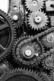 Old gears and cogs of engine mechanism. Old gears and cogs with chain of engine mechanism - black and white Stock Images
