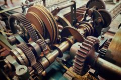 Old gears and cogs of spinning machine. Vintage colour style Stock Photography