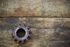 Old gears of the machine on wooden background Stock Images