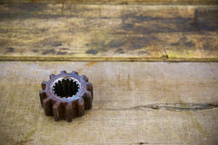 Old gears of the machine on wooden background Stock Photos