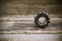 Old gears of the machine on wooden background. The gears on vintage picture style Royalty Free Stock Photos