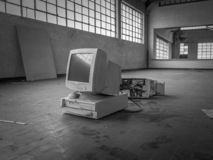 Old generation computer in warehouse, black and white. stock photography