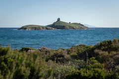 Genoese tower on an island, near the shore in Corsica. royalty free stock photos