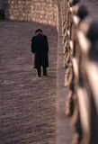 Old gentleman. An old gentleman with a hat and coat walks alone Royalty Free Stock Photography