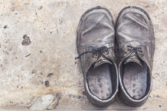 Old genuine leather shoes on concrete background Stock Photography
