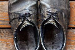 Old genuine leather shoes on a wooden background Royalty Free Stock Photography