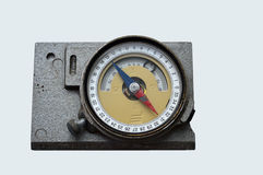 Old geological compass on the grey background. Have served many years. Rarity royalty free stock image