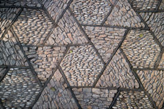 Old geometric pattern cobblestone paving stone  road Stock Photography