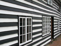 Old georgian shiplap weatherboard house. Photo of a georgian shiplap weatherboarded house with panels painted in black and white stock photo