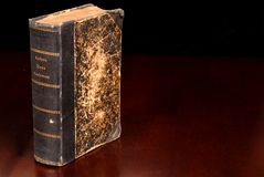 Old German bible standing on a table. Awash in warm light Royalty Free Stock Image