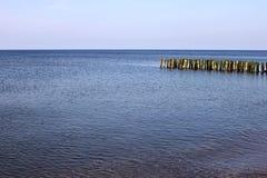Old german breakwater on the Baltic Sea coast. Royalty Free Stock Image