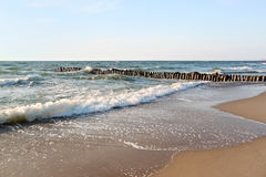 Old german breakwater on the Baltic Sea coast at summer. Stock Image