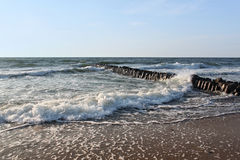 Old german breakwater on the Baltic Sea coast at summer. Royalty Free Stock Image