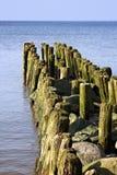 Old german breakwater on the Baltic Sea coast. Royalty Free Stock Photos