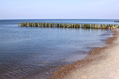 Old german breakwater on the Baltic Sea coast. Royalty Free Stock Images