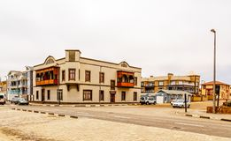 Old German colonial buildings and crossroad with some traffic, S. Wakopmund, Namibia stock images