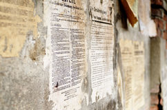 Old german damaged poster newspaper news on a wall Royalty Free Stock Photos