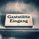 Old German door sign of a restaurant of the 60s Royalty Free Stock Photography