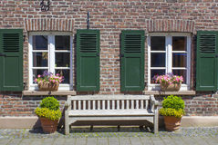 Old German house with windows with wooden shutters Stock Image