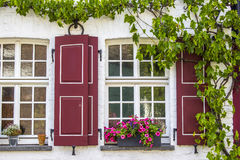 Old German house with windows with wooden shutters Stock Images