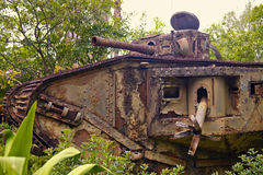Old German tank. World War One German tank standing among trees and bushes Stock Image