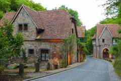 Old German village street in the evening. Old German village street with a garden bench royalty free stock image