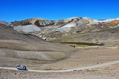 Old german vintage campervan cruising road in the andean mountains, Peru, South America. Old german vintage campervan cruising an abondend road in the peruvian royalty free stock photos