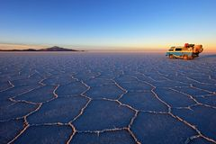 Old german vintage campervan on Salar de Uyuni, salt lake, Bolivia. Old german vintage campervan on Salar de Uyuni, salt lake, is largest salt flat in the world royalty free stock photos