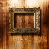 Old gilded picture frame for portrait Stock Photos