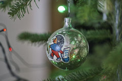 Old glass ball with picture on cristmas tree close up, hedgehog postman, postbag, Stock Image