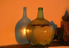Old Glass Bottle. Bathed in orange light Royalty Free Stock Photo