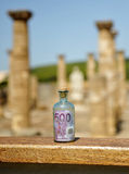 Old glass bottle with 500 euro banknote inside, power of money Stock Photo