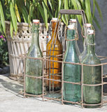 Old glass bottles on doorstep Royalty Free Stock Images
