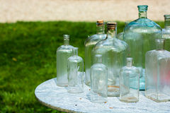 Old Glass Bottles On Table Royalty Free Stock Photos